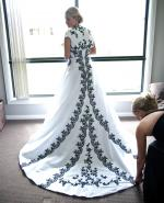 Beautiful White Wedding Dress with Black Embroidery and Beading and Cathedral Train.