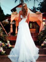Custom made and uniquely beautiful wedding dress, perfect for beach weddings!